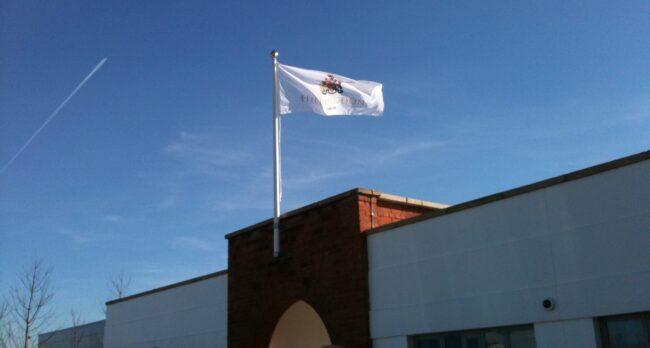 Custom flags - Wall Mounted Flag with Huntington Logo