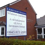 Front of Lioncourt homes post signs