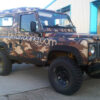 Brown camouflage car wrap with Branding