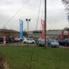 A group of ultimate flagpoles outside a vehicle sales showroom